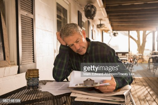 Caucasian businessman working on patio