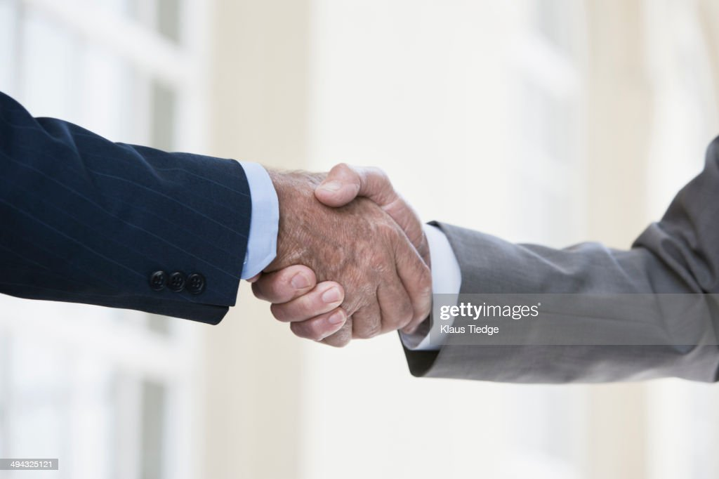 Caucasian businessmen shaking hands