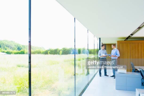Caucasian businessmen talking in modern office