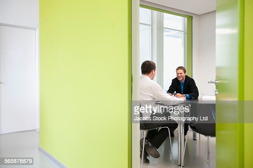 Caucasian businessmen talking in office meeting