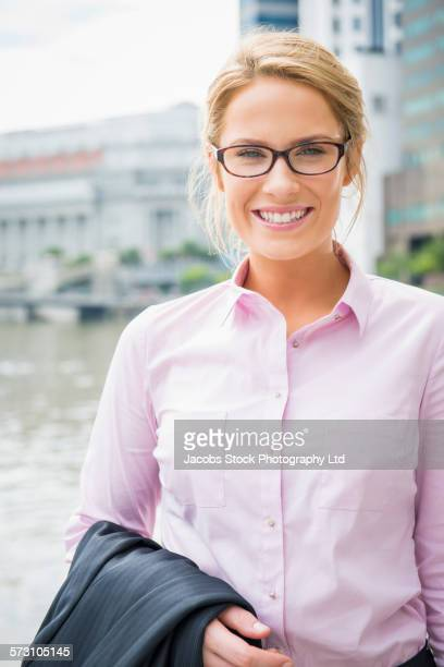 Caucasian businesswoman smiling outdoors