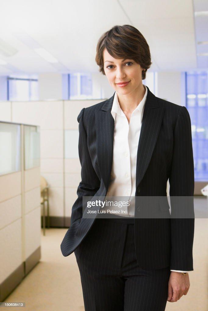 Caucasian businesswoman standing in office : Stock Photo
