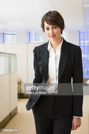 Caucasian businesswoman standing in office : Stock Photo