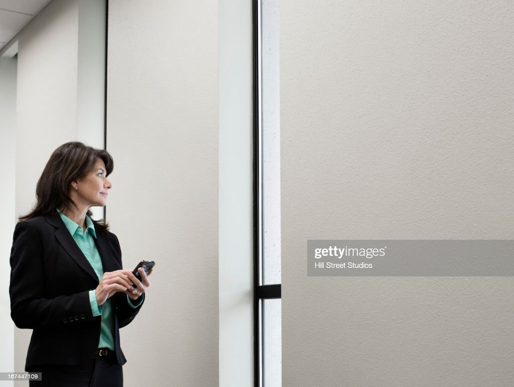 Caucasian businesswoman using cell phone : Stock Photo