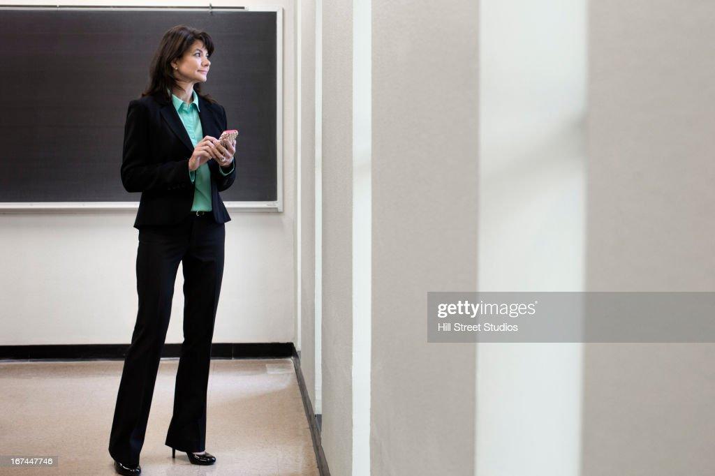 Caucasian businesswoman using cell phone : Stock Photo