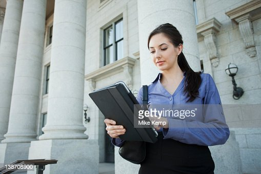 Caucasian businesswoman using digital tablet outdoors