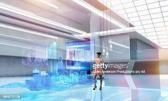 Caucasian businesswoman using hologram computer screen