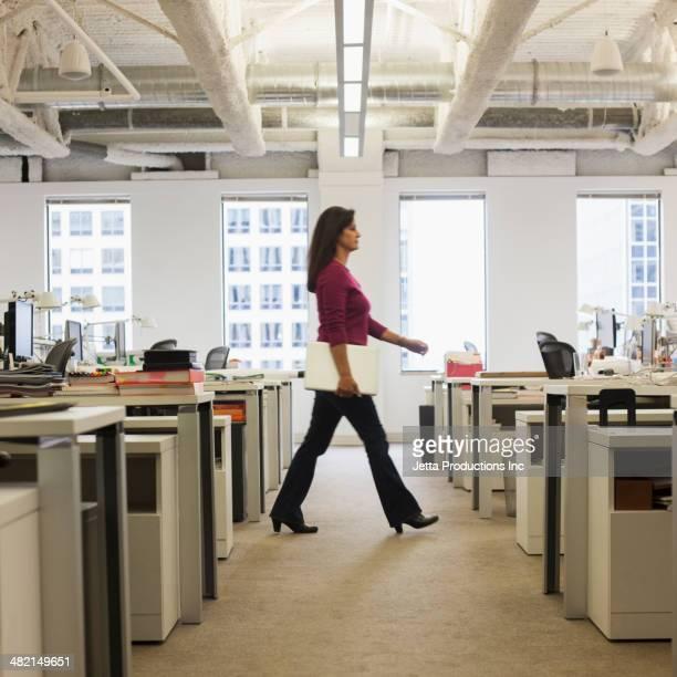 Caucasian businesswoman walking in office