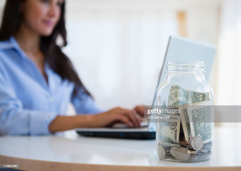 Caucasian businesswoman with tip jar