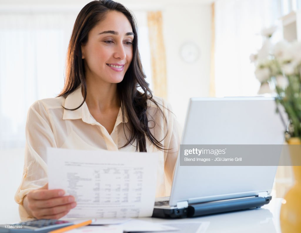 Caucasian businesswoman working at laptop : Stock Photo