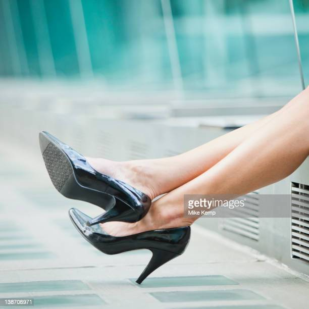 Caucasian businesswoman's legs wearing high heeled shoes