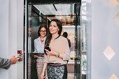 Caucasian businesswomen walking out of elevator