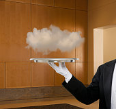 Caucasian butler holding tray with cloud