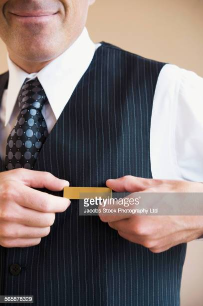 Caucasian butler wearing name tag in hotel