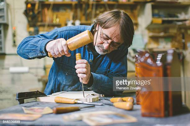 Caucasian carpenter in workshop