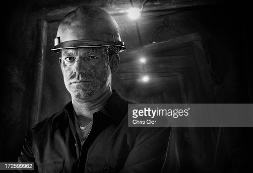 Caucasian carpenter wearing hard hat