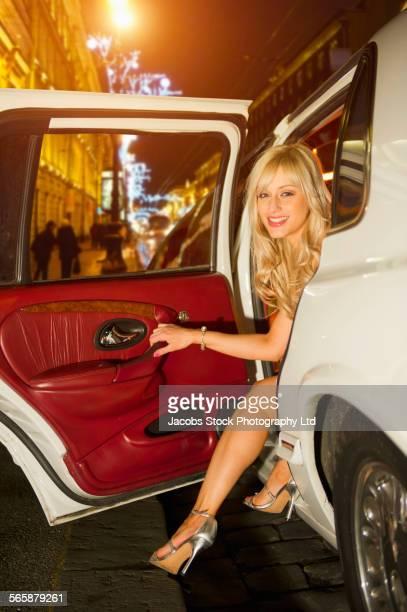 Caucasian celebrity exiting limousine
