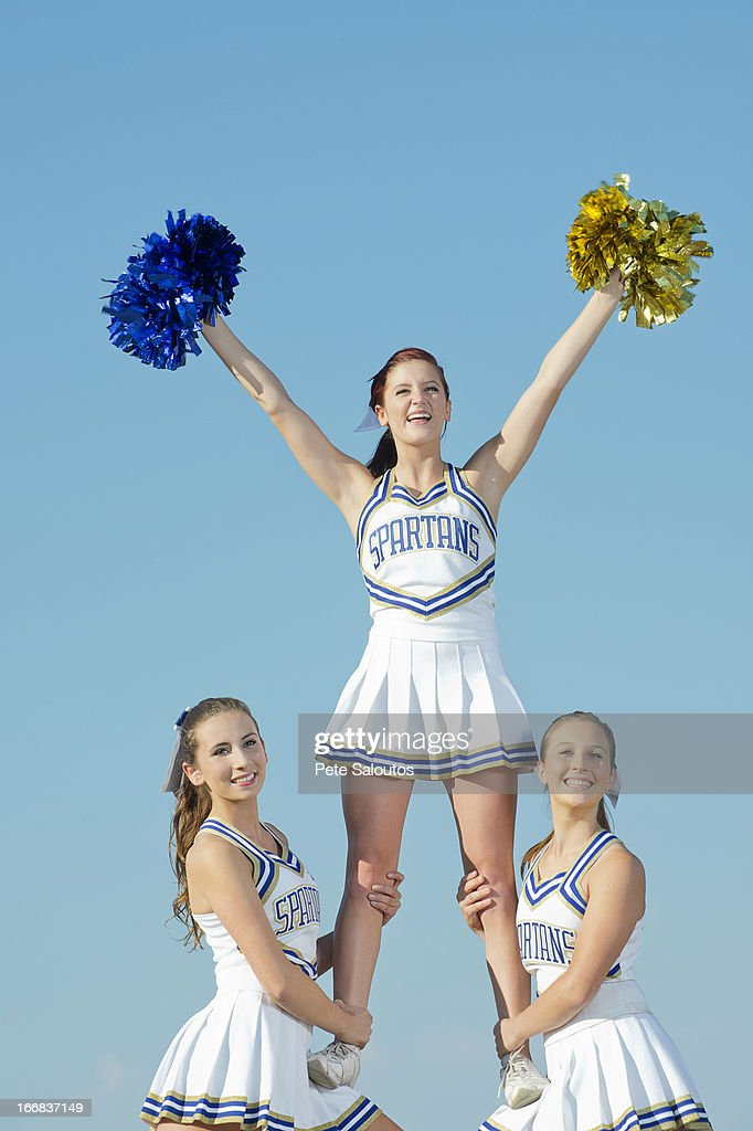 Caucasian cheerleaders posing together : Stock Photo