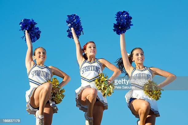 Caucasian cheerleaders posing together