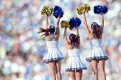 Caucasian cheerleaders posing together