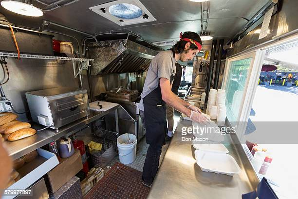 Caucasian chef working in food truck kitchen