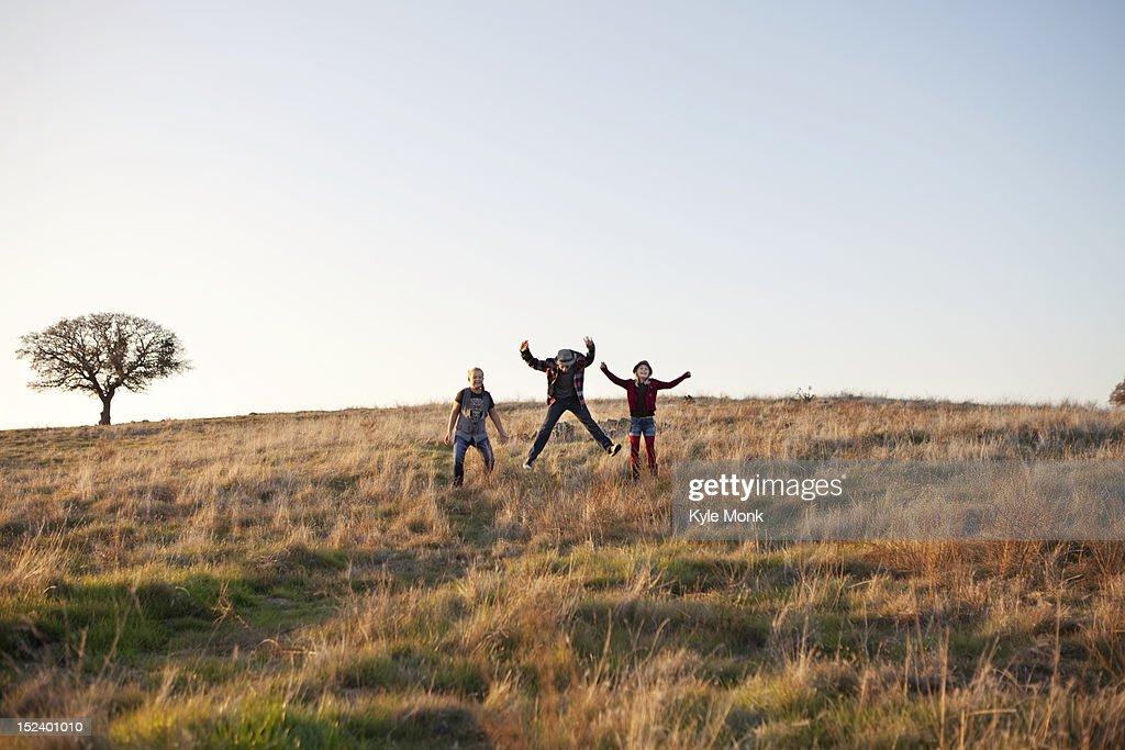 Caucasian children playing in field