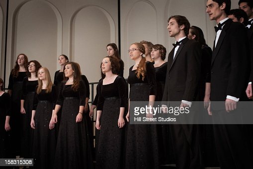 Caucasian choir performing on stage