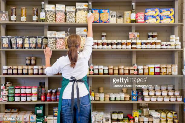 Caucasian clerk working in grocery store