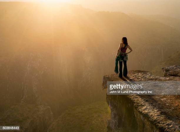 Caucasian climber overlooking rocky mountaintop