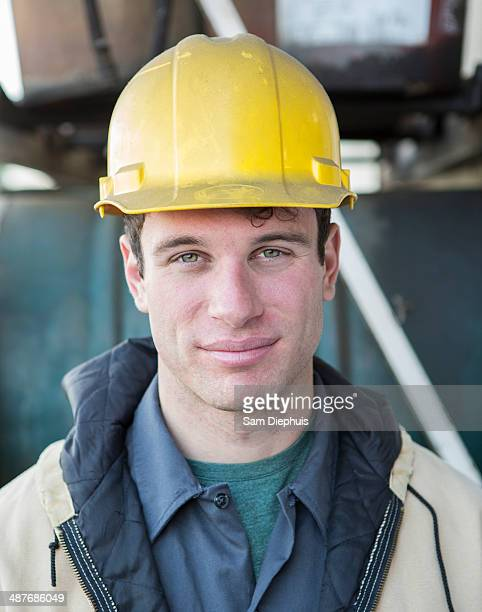 Caucasian construction worker smiling outdoors