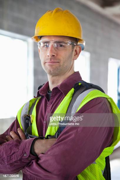 Caucasian construction worker with arms crossed