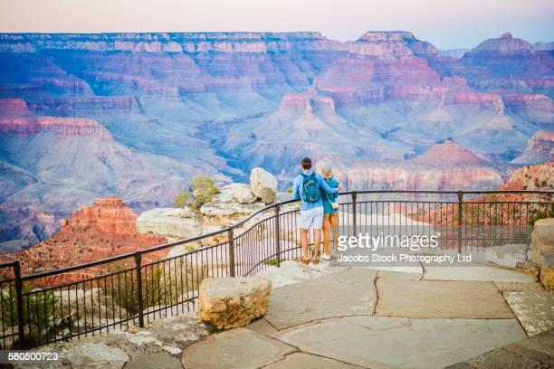 Caucasian couple admiring Grand Canyon, Arizona, United States