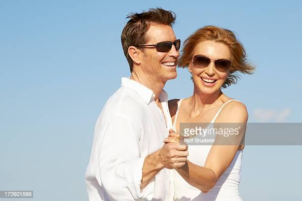 Caucasian couple dancing outdoors