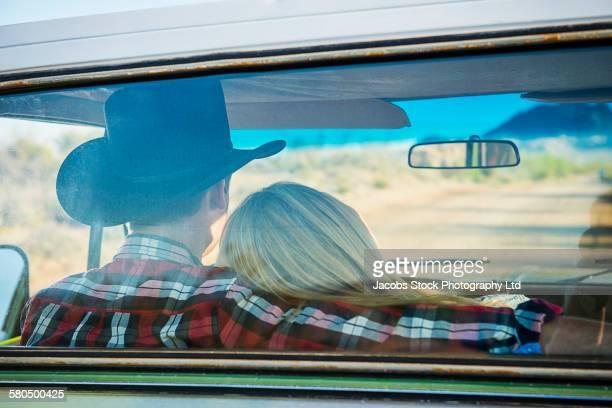 Caucasian couple driving truck