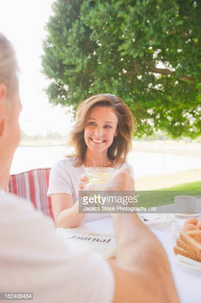 Caucasian couple enjoying breakfast together