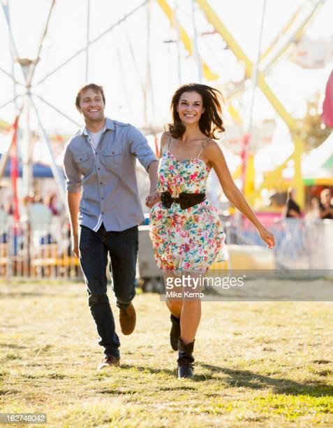 Caucasian couple enjoying carnival