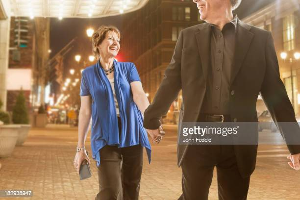 Caucasian couple holding hands outdoors