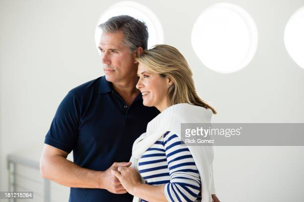 Caucasian couple holding hands