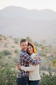 Caucasian couple hugging in desert