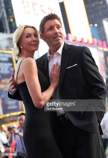 Caucasian couple hugging in Times Square, New York City, New York, United States