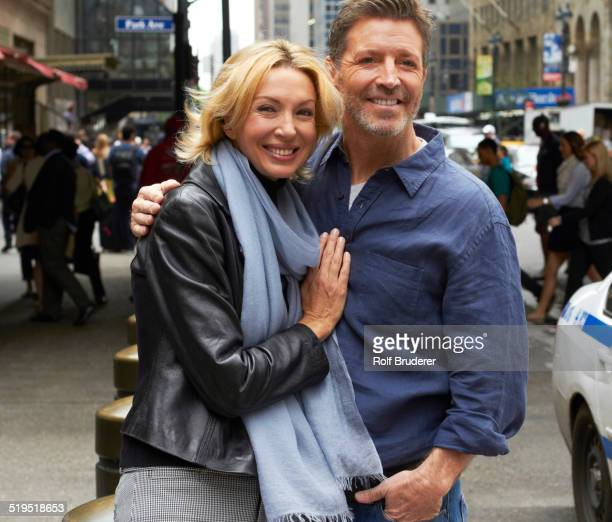 Caucasian couple hugging on city street, New York City, New York, United States