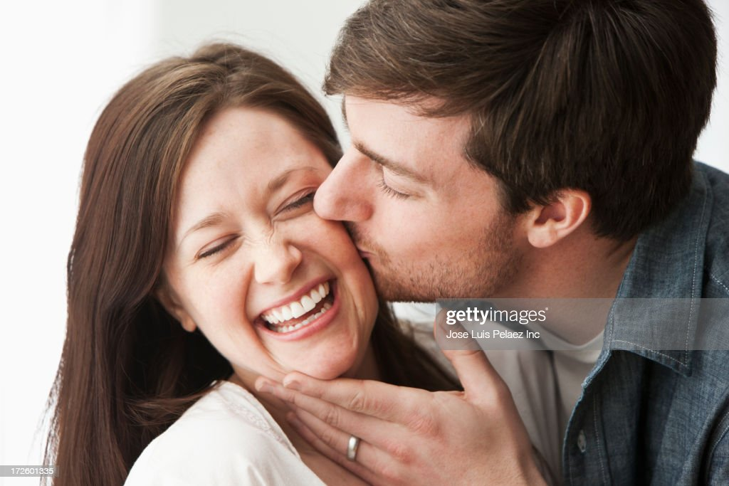 Caucasian couple kissing : Stock Photo
