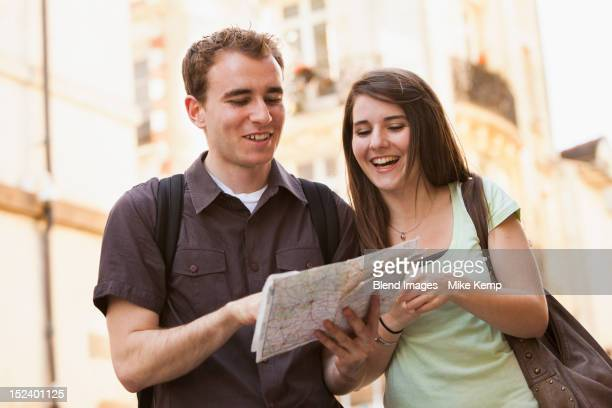 Caucasian couple looking at map