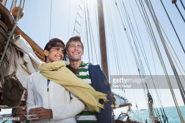 Caucasian couple on sailboat
