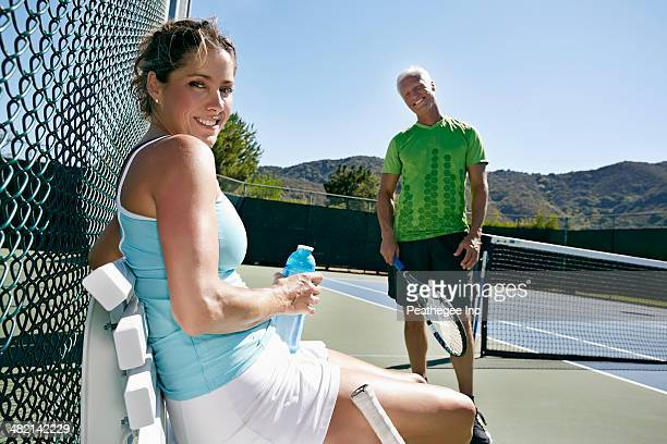 Caucasian couple on tennis court