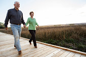 Caucasian couple on wooden walkway