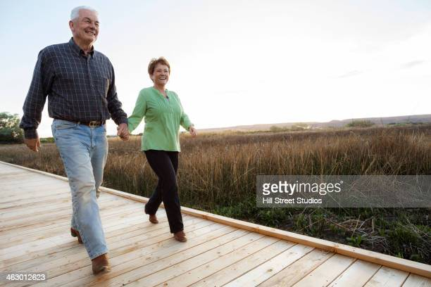 Caucasian couple on wooden walkway