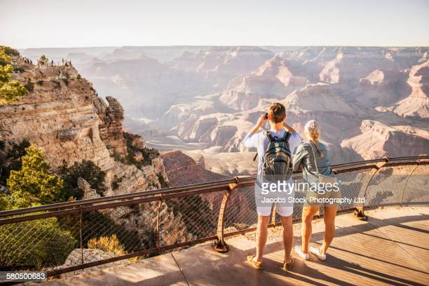 Caucasian couple photographing Grand Canyon, Arizona, United States