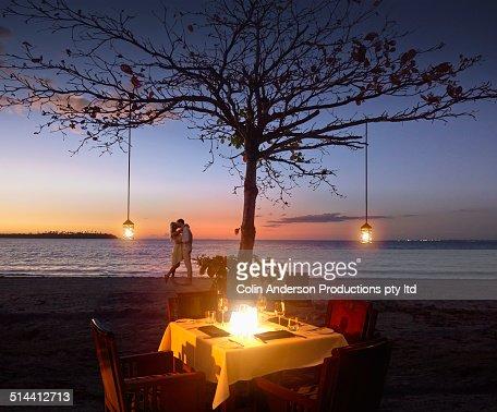 Caucasian couple relaxing at beach restaurant