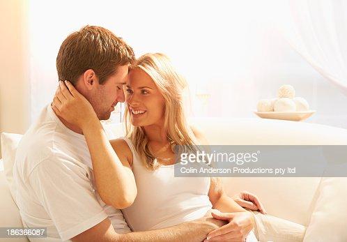 Caucasian couple relaxing on sofa